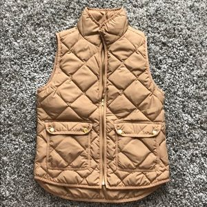 J Crew camel colored puffy vest.